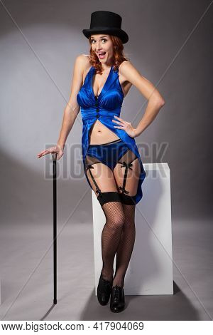 Pretty Woman In Blue Performer Costume Suit With Hat And Cane. Studio