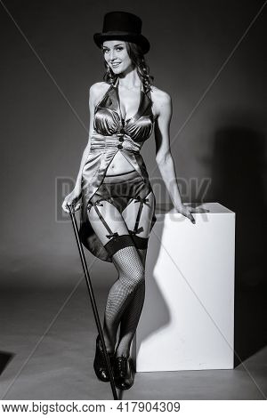 Pretty Woman In Performer Costume Suit With Hat And Cane. Studio