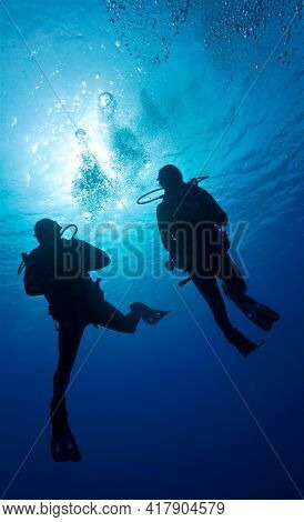 Underwater Photo Scuba Divers In Rays Of Sunlight. From A Scuba Dive In The Atlantic Ocean Off The C