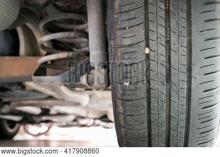 Small Stone Embedded In The Treads Of Tire.