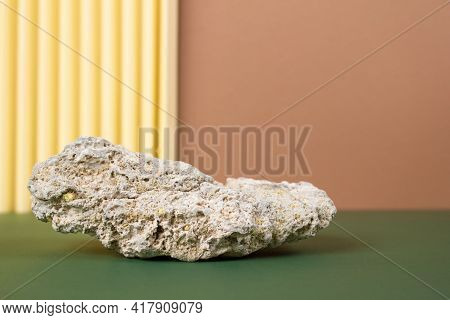 Modern Still Life Composition With Natural Stone Against Background In Neutral Colours With Copy Spa