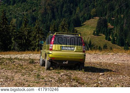 Honda Hr-v On Mountains Road, Rocky Cliffs. Car In Front Of Mountains Forest In Vartop, Romania, 202