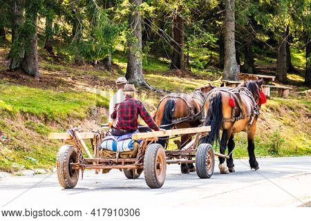 Horse Carriage On Mountain Road In Bihor, Romania, 2021