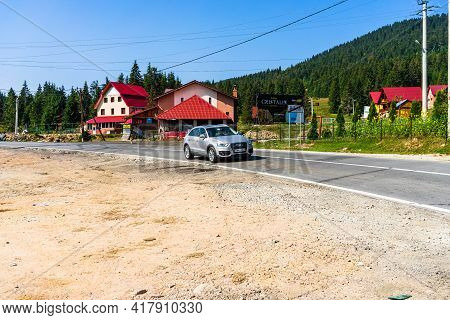 View Of Mountain Road Thorugh Houses And Trees In Bihor, Romania, 2021