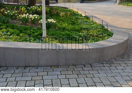 Retaining Seat Wall Made Of Pure Cast Concrete Blooms Purple Flowers Behind It The Wall Is Bordered