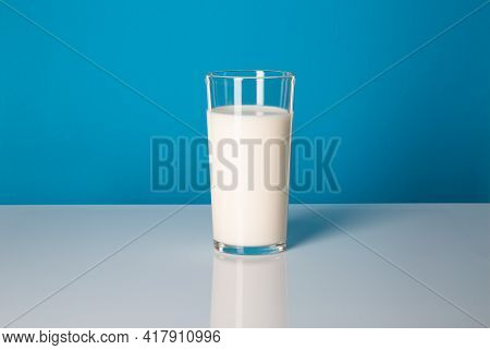 Milk And Fermented Milk Products: Benefits For The Body. Glass Of Milk On A Blue Background.