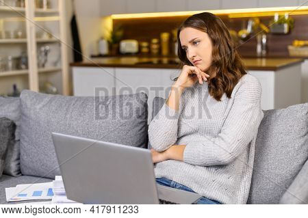 Female Entrepreneur Sits On The Couch, Works With The Laptop And Feels Bored, 30s Woman Has Not Insp