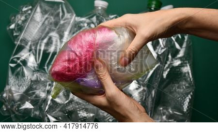 Waste Sorting Concept. Hands Hold Transparent Plastic Bags For Recycling. Preparation Of Recycled Ho