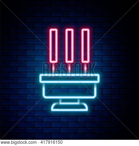 Glowing Neon Line Burning Aromatic Incense Sticks Icon Isolated On Brick Wall Background. Colorful O