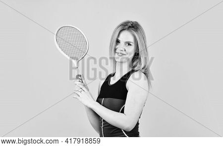 Tennis Player Prepares To Serve Ball. Beautiful Female Tennis Player. Woman With Badminton Racket. G