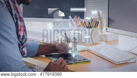 Composition of digital icons and data processing over man using graphic tablet in office. global technology and digital interface concept digitally generated image.