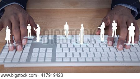 Composition of white people silhouettes over man using computer keyboard. global technology and digital interface concept digitally generated image.