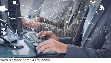 Composition of network of connections with digital icons over two businessmen using computers. global technology and digital interface concept digitally generated image.