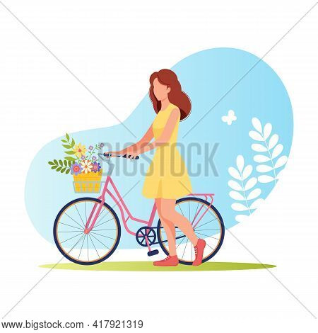 Young Girl In Summer Dress With Bicycle, With Basket Of Flowers. Cycling In Nature. Charming Red-hai