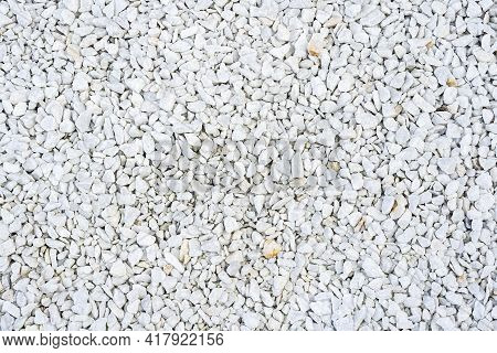 Road Gravel, Crushed Stone. Gravel Texture. Crack Stones At A Construction Site. Seamless Texture Of