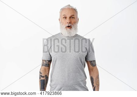 Wow Awesome. Impressed Mature Man With Tattoos And Beard, Drop Jaw, Gasping And Looking In Awe And E