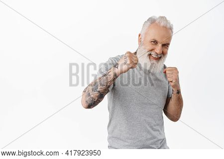 Look At My Jab. Smiling Playful Senior Man Wants Sparring, Standing In Boxing Boxer Pose And Ready F
