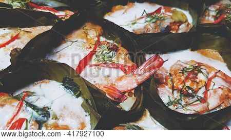 Close Up Steamed Shrimp Curry In A Banana Leaf Cup On Steamer Pot. Famous Food In Thailand Using Mix