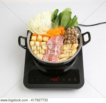 Induction Cooktop With Sukiyaki Pot Isolated On White Background