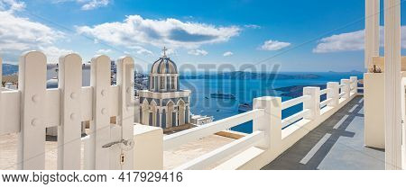 Santorini Island Greece. Stunning White Architecture With Blue Church Dome. White Fence And White Do