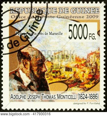 Moscow, Russia - April 20, 2021: Stamp Printed In Guinea Shows French Artist Adolphe Monticelli And