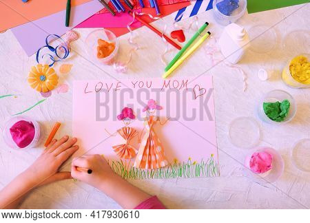 Child Making Homemade Greeting Card From Paper And Clay, Plasticine As Gift For Mothers Day, Birthda
