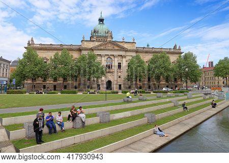 Leipzig, Germany - May 9, 2018: People Sit In City Park By Federal Administrative Court (bundesverwa