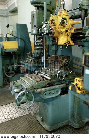 Drilling Machine In The Old Shop. Drilling Machine Parts And Spindle With Drills.