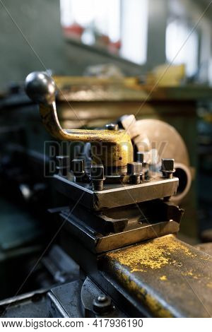 Old Locksmith Lathe, Components And Tools. Lathe Close-up, Metal With A Blurred Background.