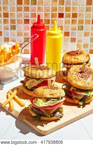 Appetizing Homemade Burgers On Wooden Cutting Board With Bright Sunlight. Burger With Veal Cutlets,