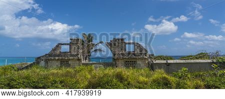 Ancient Ruins On Isla Mujeres, Cancun, Mexico With Beautiful Blue Sky With Clouds In Background