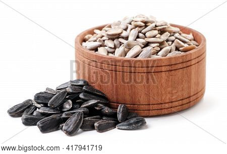Seeds Peeled In A Plate And Not Peeled Close-up On A White Background. Isolated