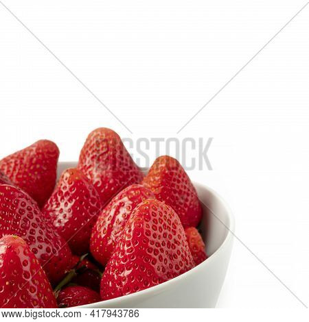 Strawberry Tips White Bowl Front View. Strawberries In White Plate Close-up Isolated On White Backgr