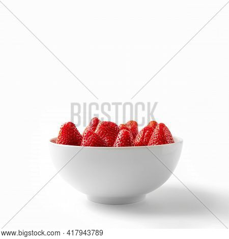 Strawberry In White Bowl Front View. Strawberries In White Plate Close-up Isolated On White Backgrou