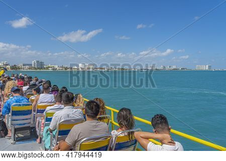 Cancun, Mexiico - March 10.2021: Ultramar Ferry Leaving To Isla Mujeres, View From The Boots Deck To