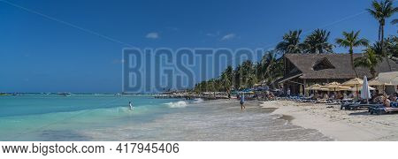 Isla Mujeres, Mexico - March 12. 2021: Playa Norte - North Beach With White Sand, Sunbeds And People