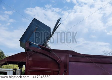 Garbage Is Loaded Into The Car The Disposal Of Municipal Waste Using A Special Car Garbage Truck In
