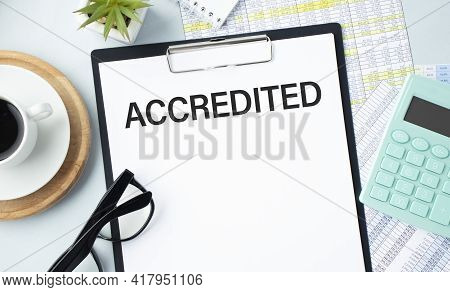 Accredited Write On A Paperwork Isolated On Office Desk.
