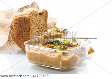 Homemade Meat Pate With Bread On A Wooden Table