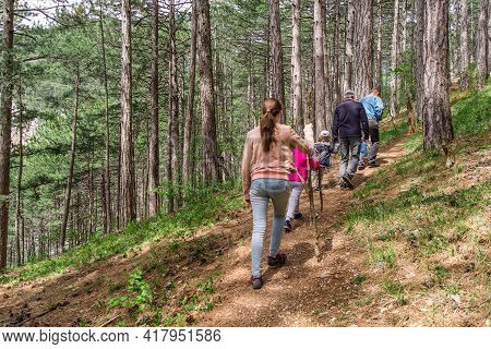 Camping, Travel, Tourism, Hike And People Concept - Happy Family Wolking In Woods