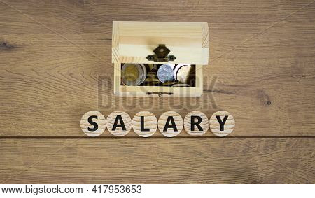 Salary Symbol. Concept Word Salary On Wooden Cubes On A Beautiful Wooden Background, Small Wooden Ch
