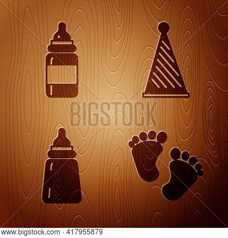 Set Baby Footprints, Baby Bottle, Baby Bottle And Party Hat On Wooden Background. Vector