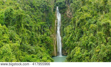 Beautiful Waterfall In Green Forest, Top View. Tropical Mantayupan Falls In Mountain Jungle, Philipp