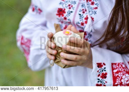 Girl In A Traditional Embroidered Shirt In A Blooming Cherry Garden.kid With Traditional Easter Cake