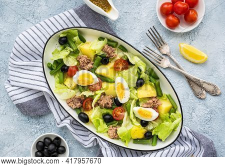 American Version Of Nicoise Salad With Canned Tuna, Boiled Potatoes And Green Asparagus Beans In An