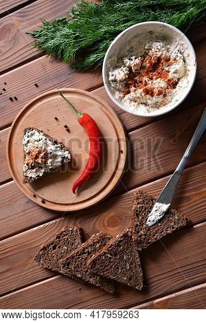 Savory Cottage Cheese Pasty With Hot Pepper, Dill And Rye Bread On The Wooden Table, Top View