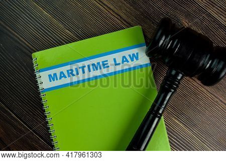 The Book Of Maritime Law Isolated On Wooden Table. Law Concept