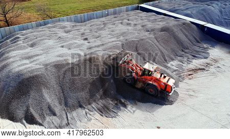 Warsaw, Poland 04.10.2019 - Using Heavy Machinery At Gravel Dump. Transporting Material To Pile. Aer