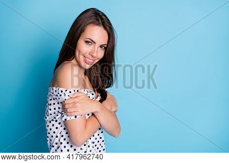 Photo Of Lovely Cute Girl Shiny Smile Cuddle Shoulders Look Camera Wear Dotted Blouse Isolated Blue