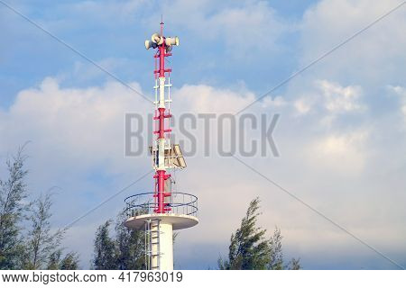 Surrounded Megaphone At The Top Of Observation Tower With Cloudy Sky Background